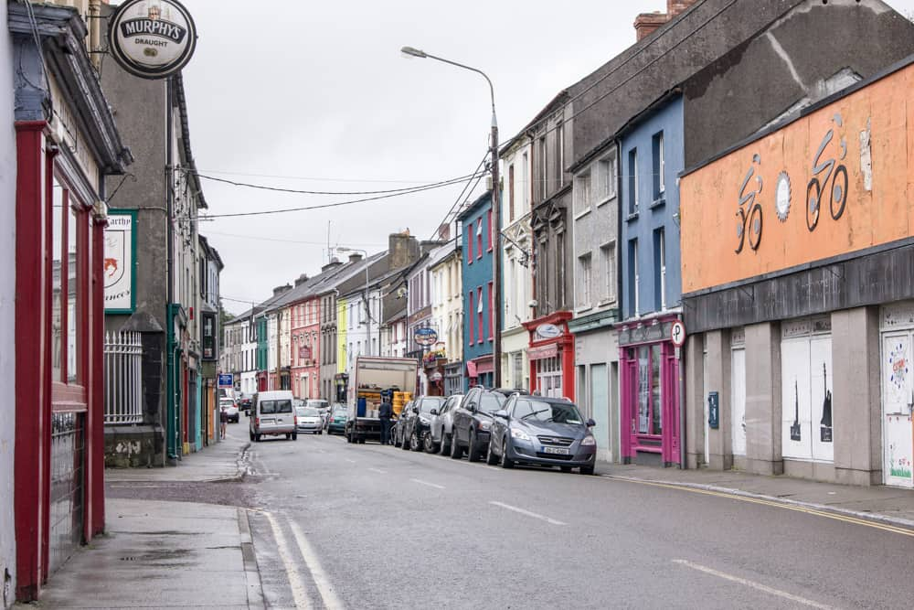 bright storefronts and buildings on street in skibbereen in ireland