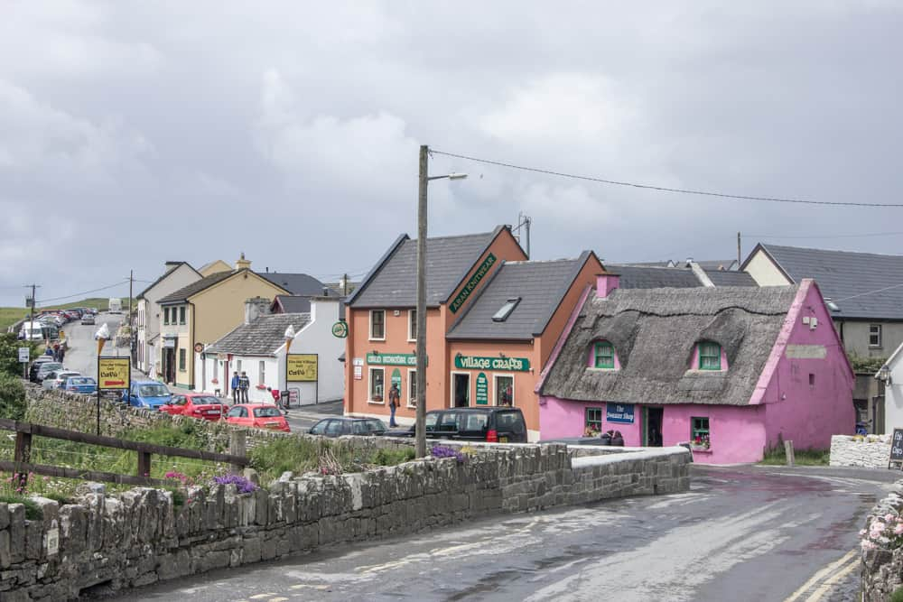 colorful main street in doolin ireland with small buildings