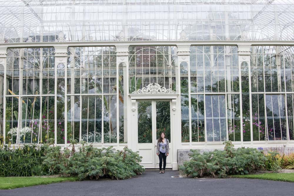 girl standing in front of national botanic gardens in dublin, ireland