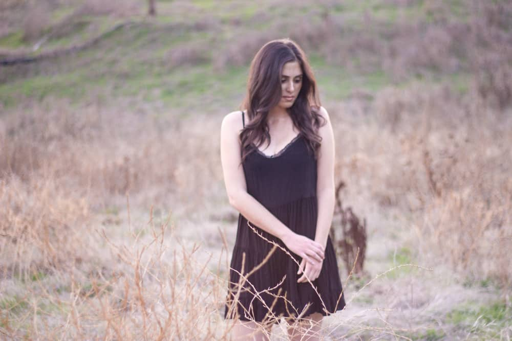 brunette girl in outdoor field