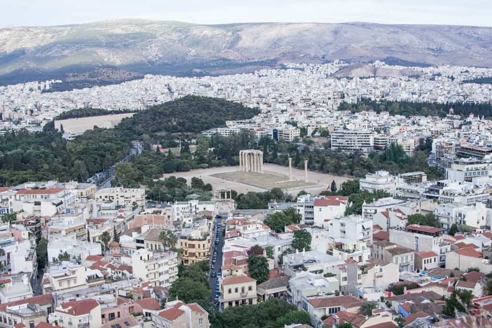 overlook of temple of olympian zeus and other colorful buildings in athens in greece