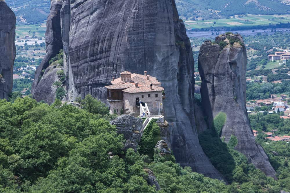 Roussanou Monastery on a cliff at Meteora in Greece above trees and giant rocks