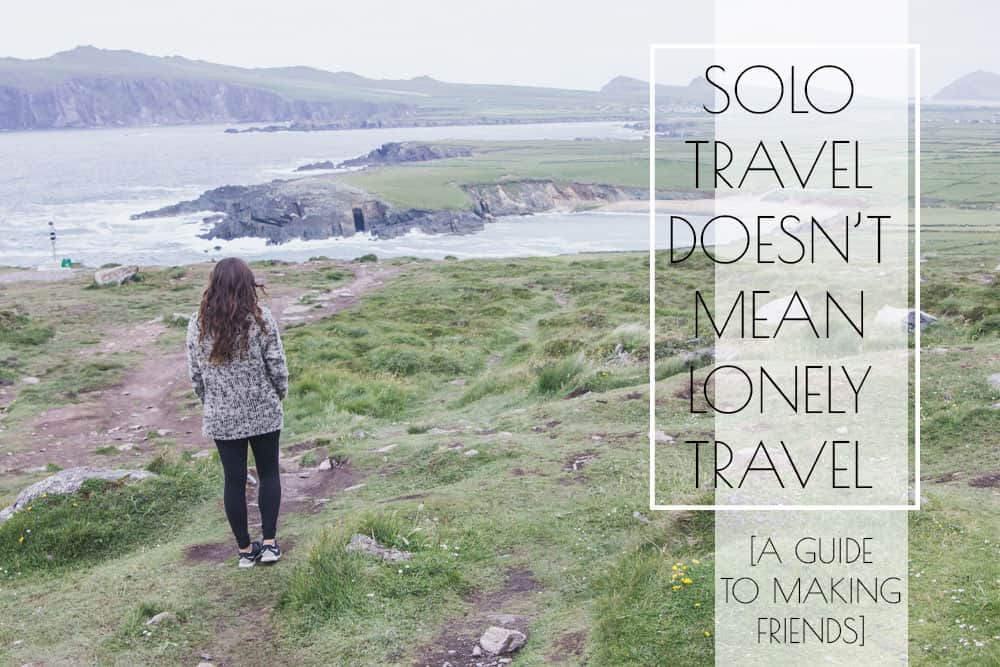 Solo travel doesn't mean lonely travel: a guide to making friends - girl standing in front of beach in ireland