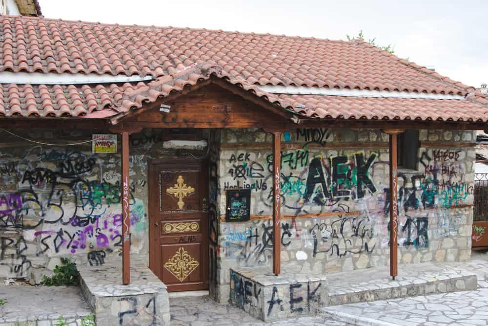 Building in Trikala covered in graffiti near Meteora