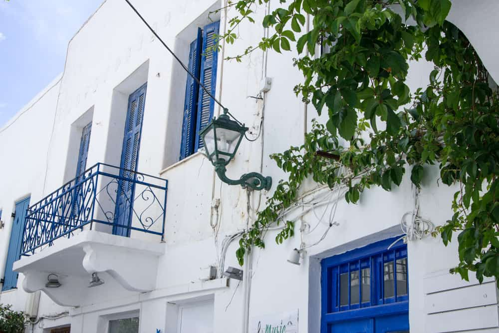 White and blue buildings in Paros, Greece in June