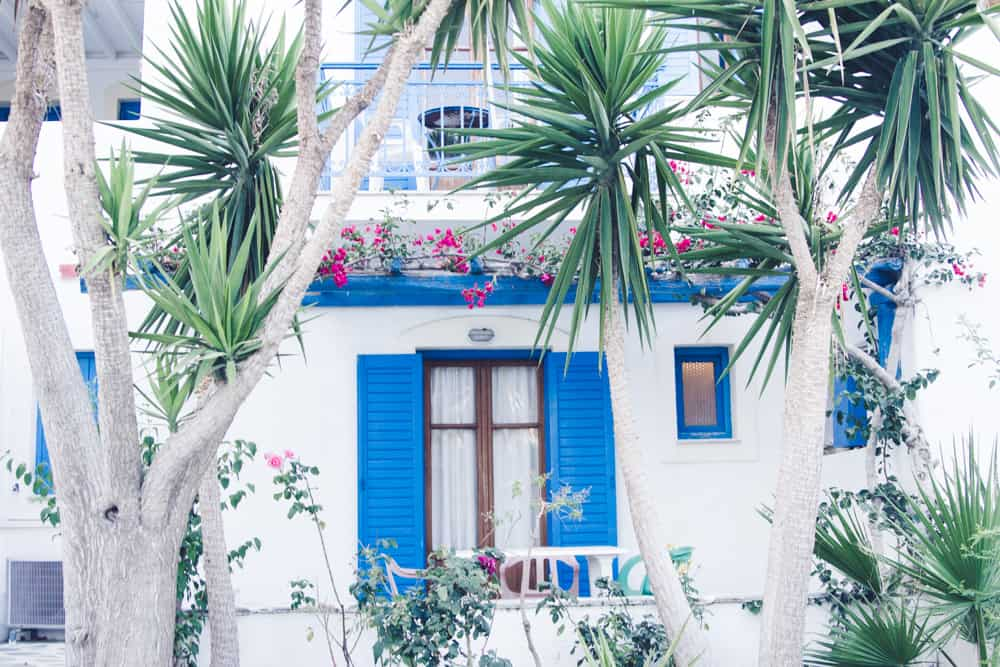 Jimi hostel is a beautiful white and blue building in paros in greece in June