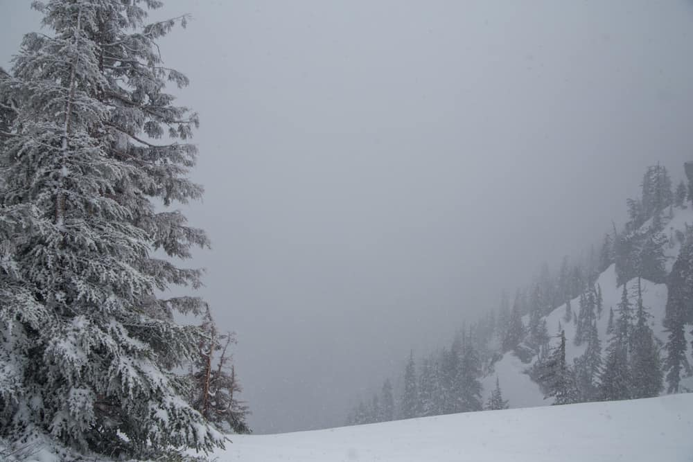 Foggy Crater Lake National Park in Oregon in the snow
