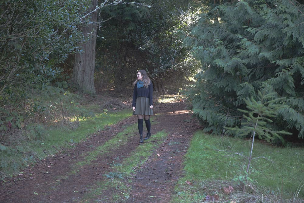 Kelsey in a tree lined pathway in Discovery Park in Seattle, Washington