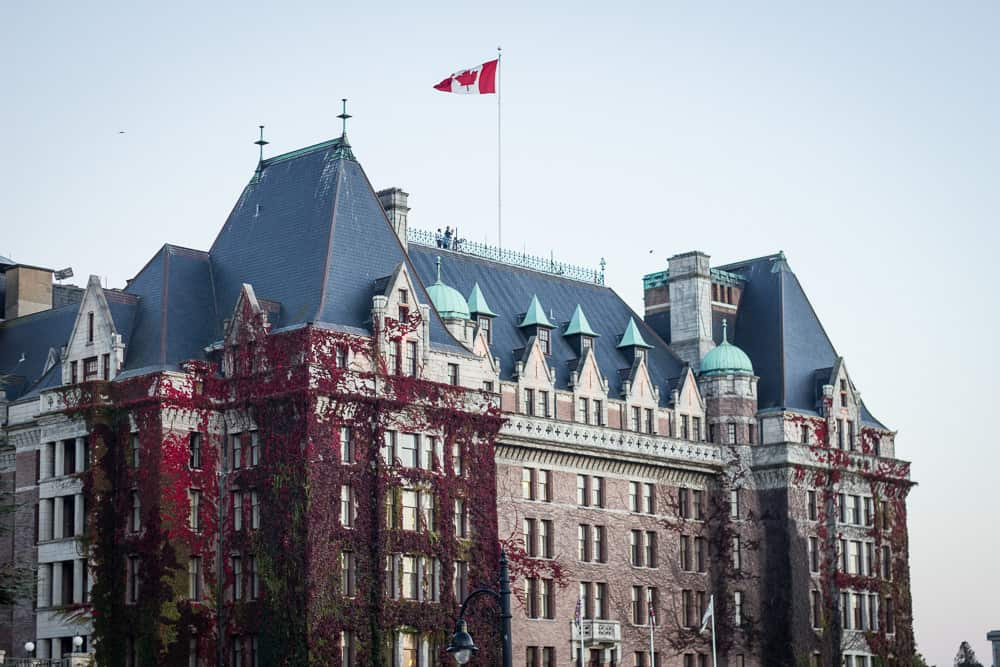 The Empress Hotel covered in red ivy in Victoria, Canada