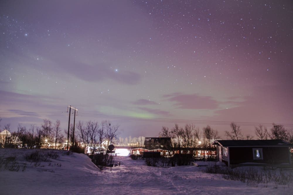 Northern Lights in Abisko, Sweden behind Hostel Haverskog in January