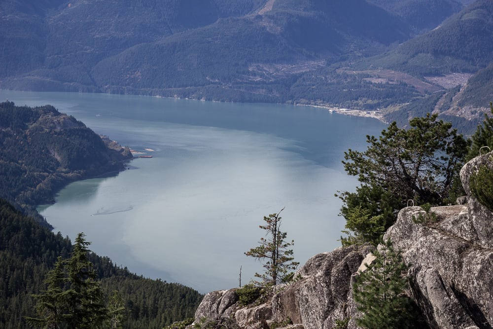 Fjord with opaque blue water in Squamish, Canada, BC at the top of the Sea to Sky Gondola