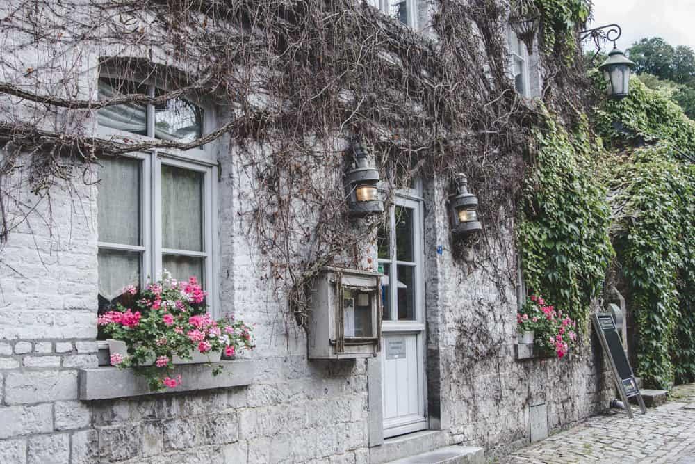 Vine-covered stone building in Durbuy, Belgium