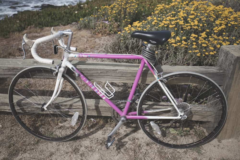 A pink and white road bike on the 17-Mile Drive in Monterey, California