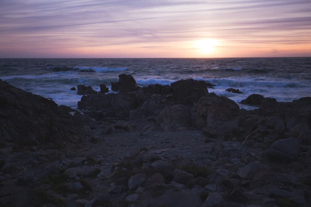 Pink ocean sunset on a bike ride along the 17-Mile Drive in Monterey, California
