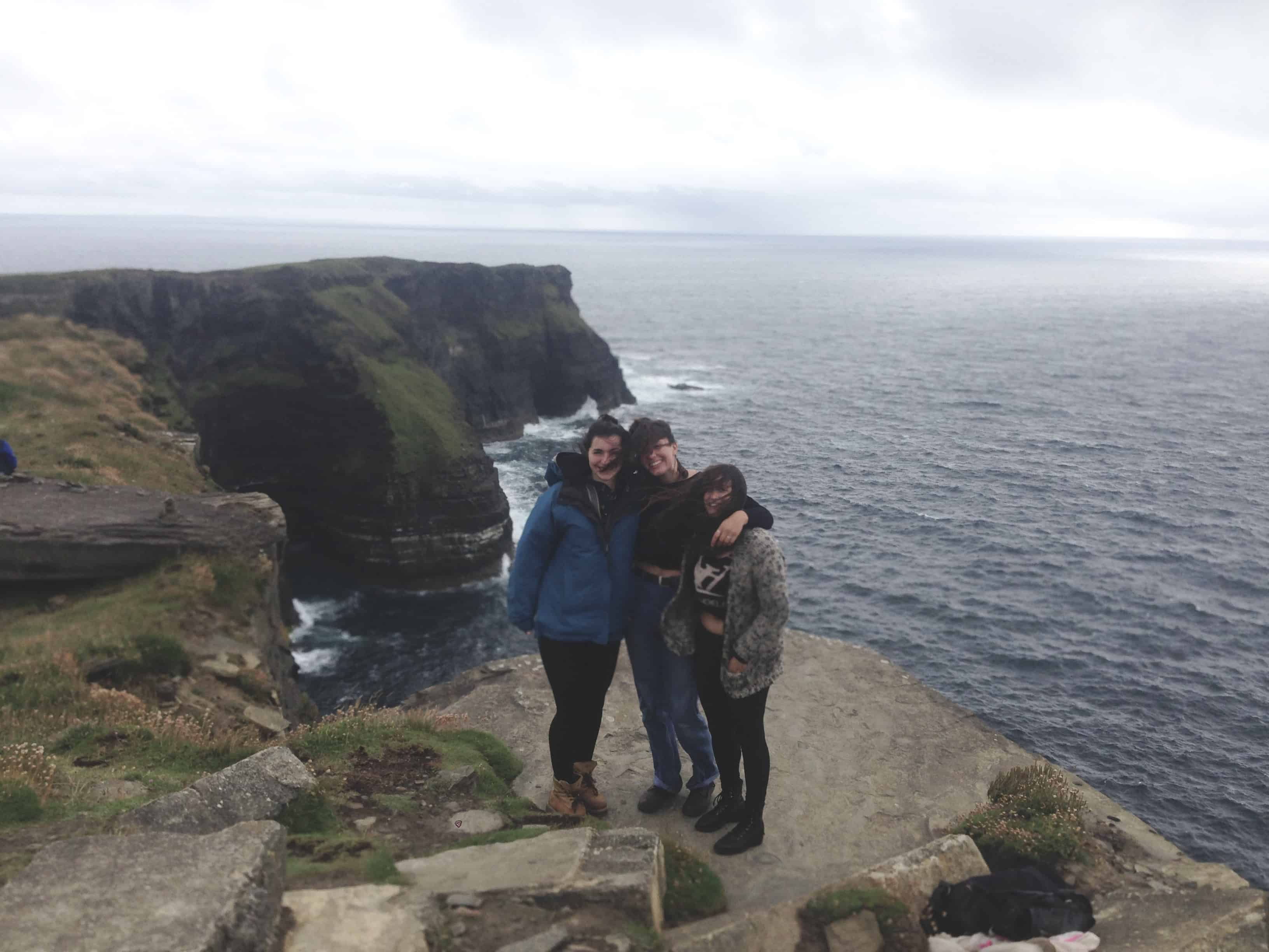 The Cliffs of Moher in Ireland on a cloudy and windy day - one of our stops while hitchhiking