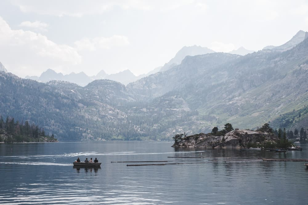 People in Boat on Lake Sabrina , surrounded by mountains in the Eastern Sierras near Bishop in California