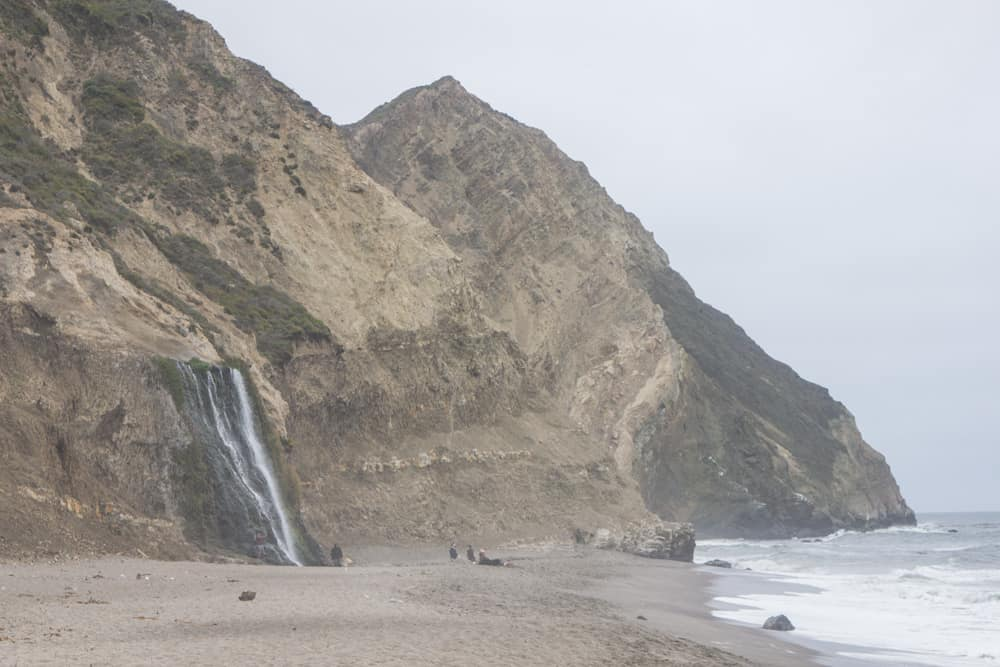 Alamere Falls, a waterfall that runs off cliffs and onto a beach, in Point Reyes in California