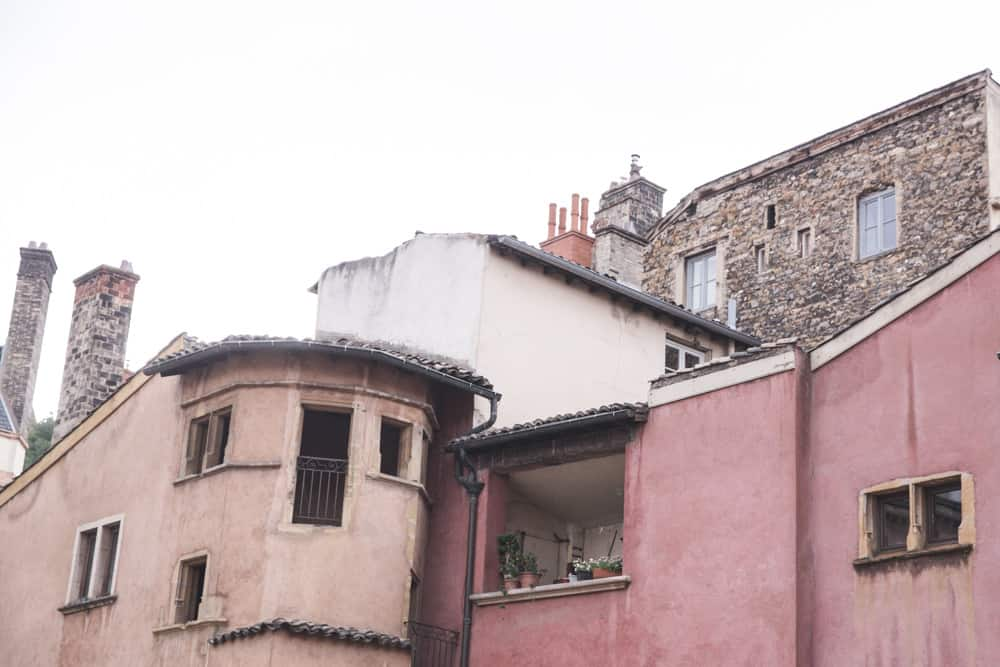 Pink, orange, white, and brown stone buildings in Old (Vieux) Lyon