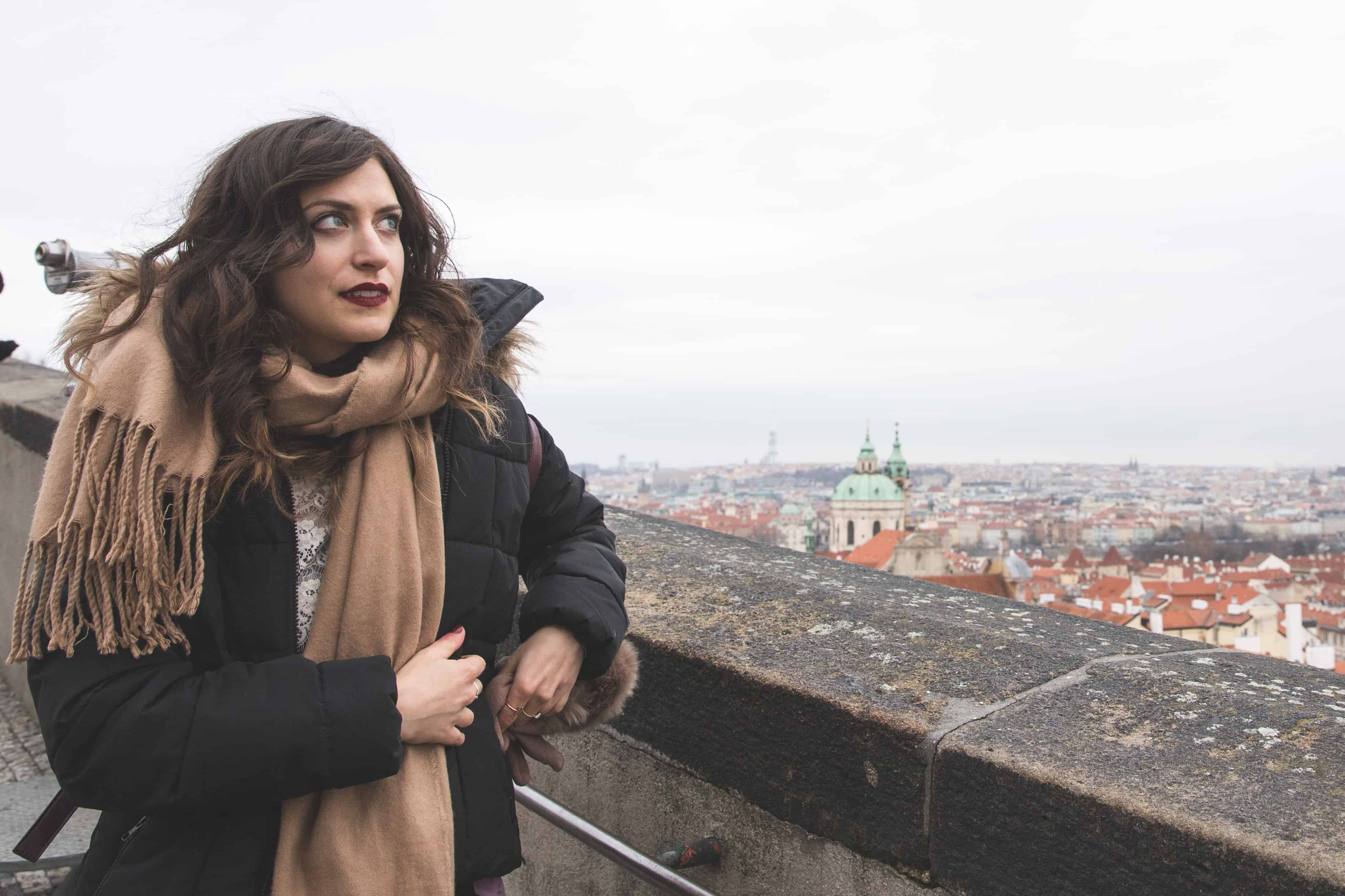 Kelsey in Prague wearing a scarf and jacket - crucial items during her 3 months in Europe in winter!