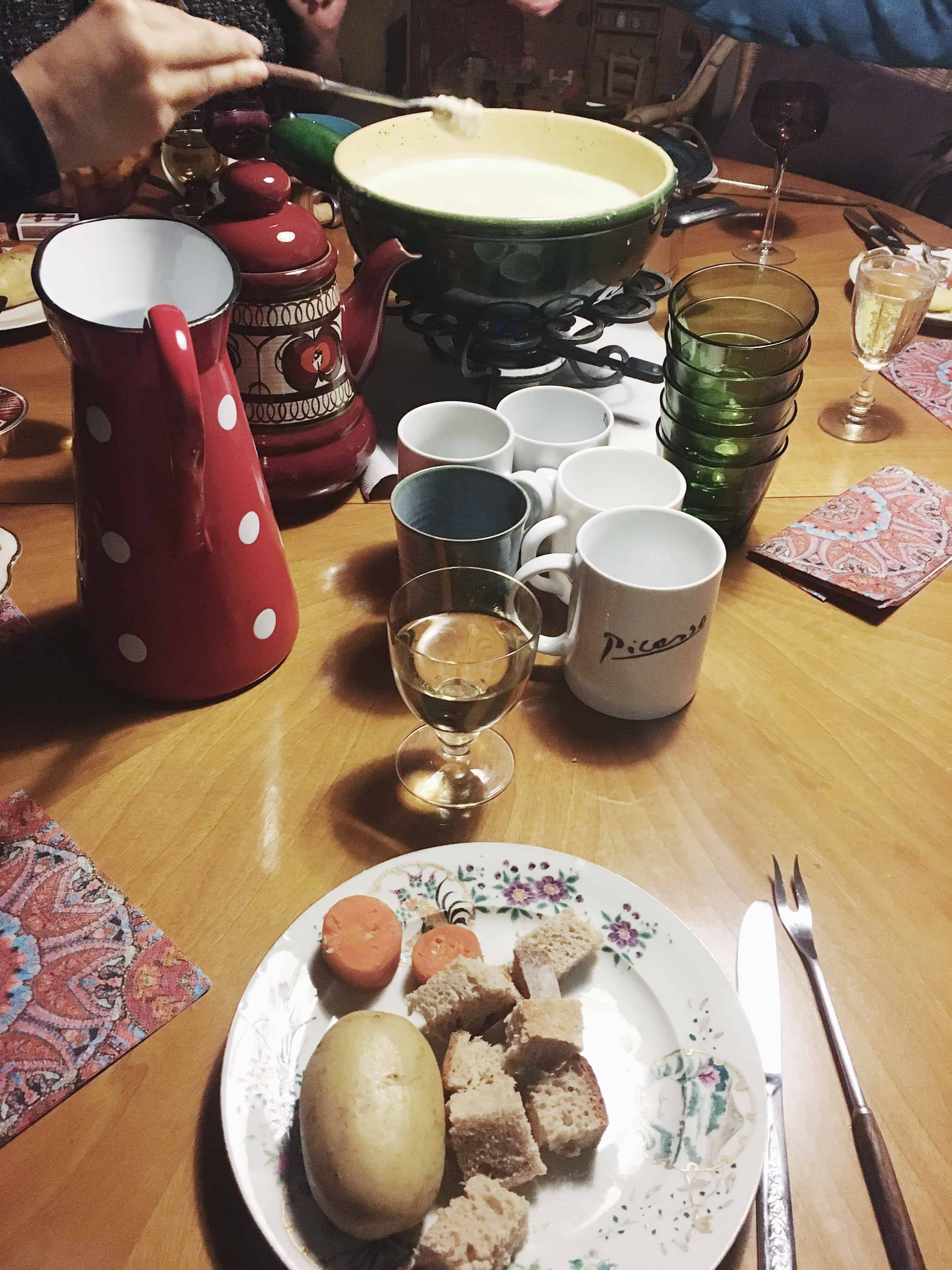 Traditional Swiss Fondue is made of cheese and eaten with bread, boiled carrots, and potatoes - try it in Switzerland!