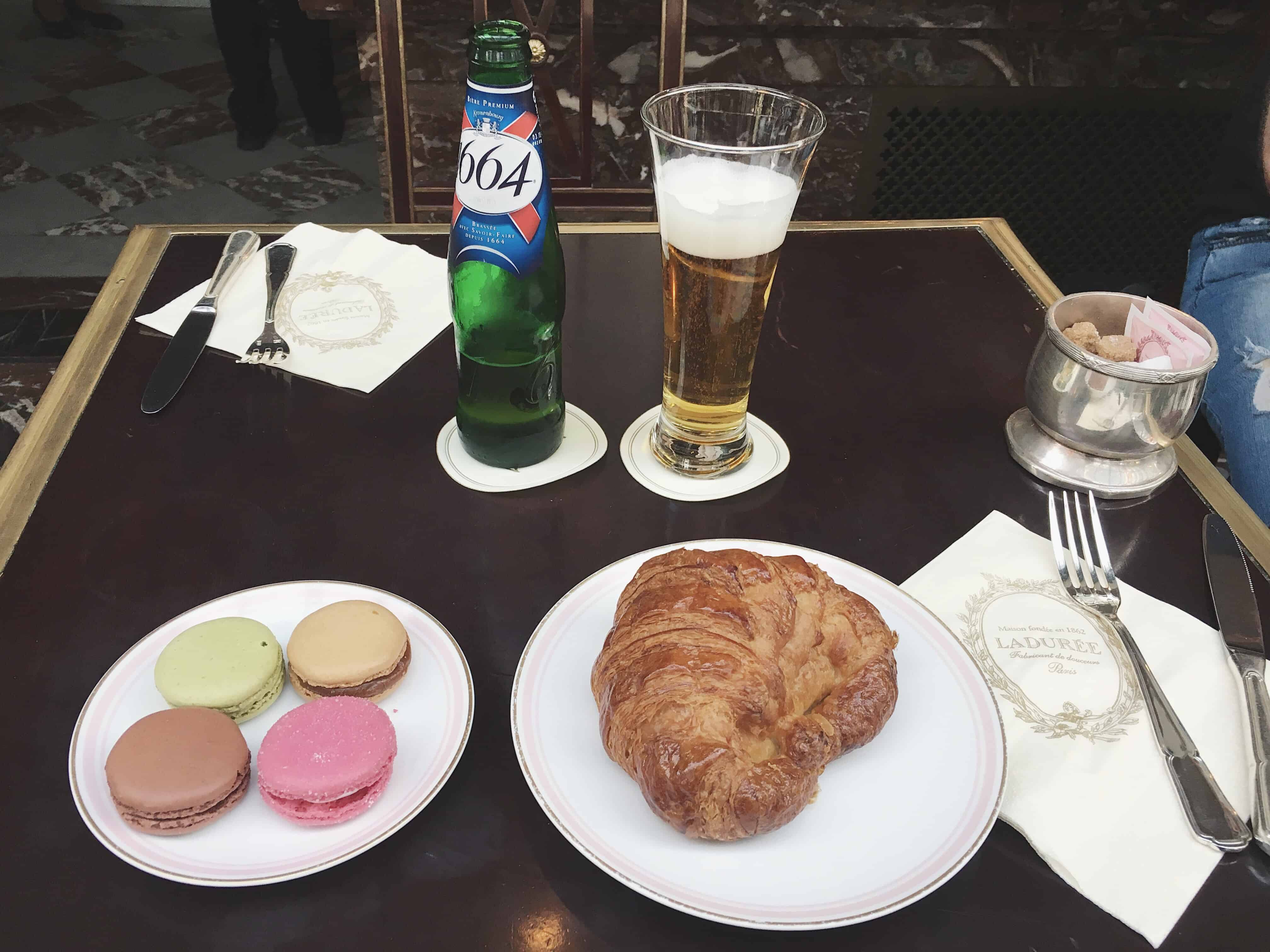 Croissant and macarons at Laudurée in Paris, France