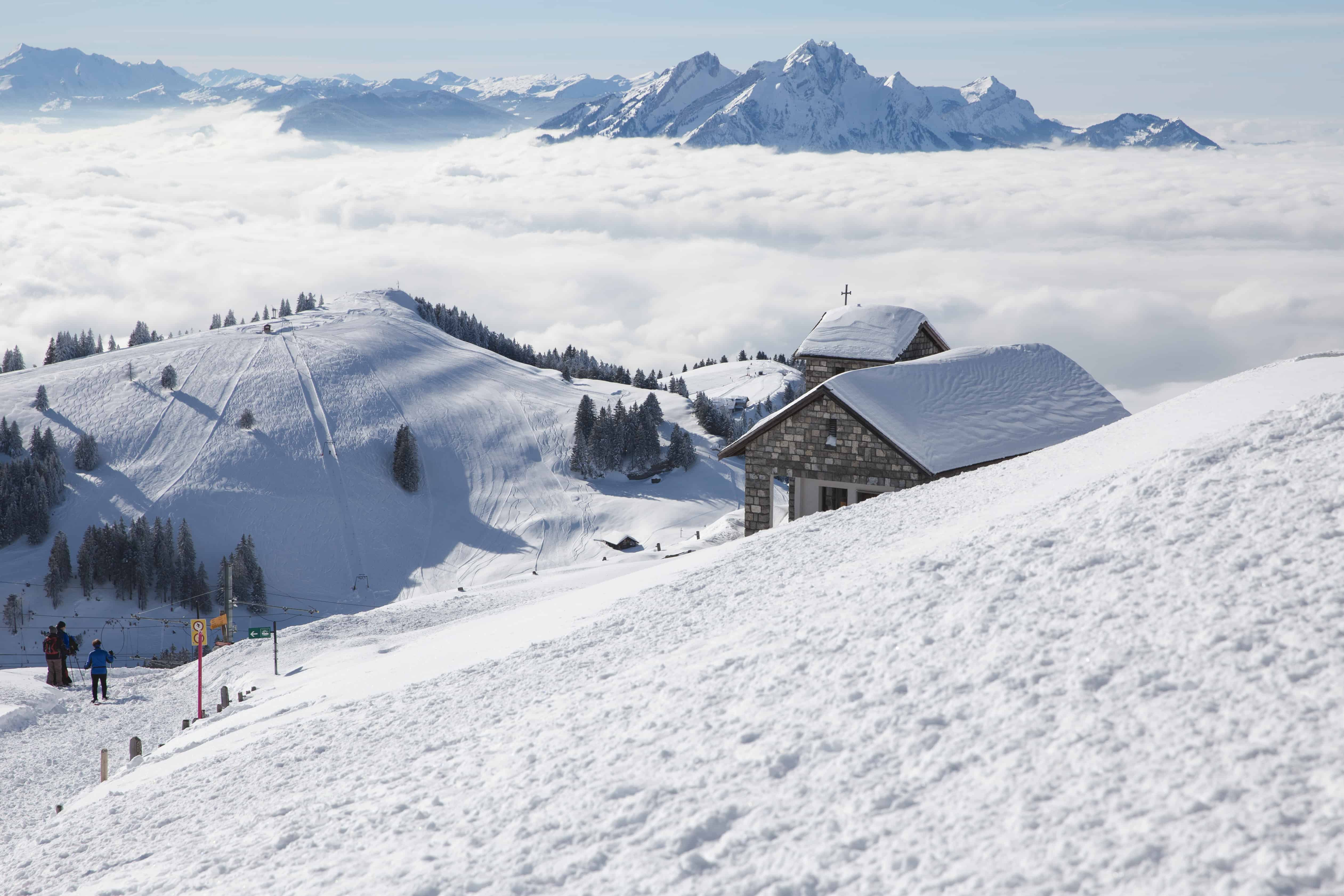The view from the top of Rigi in Switzerland is full of clouds and mountain peaks