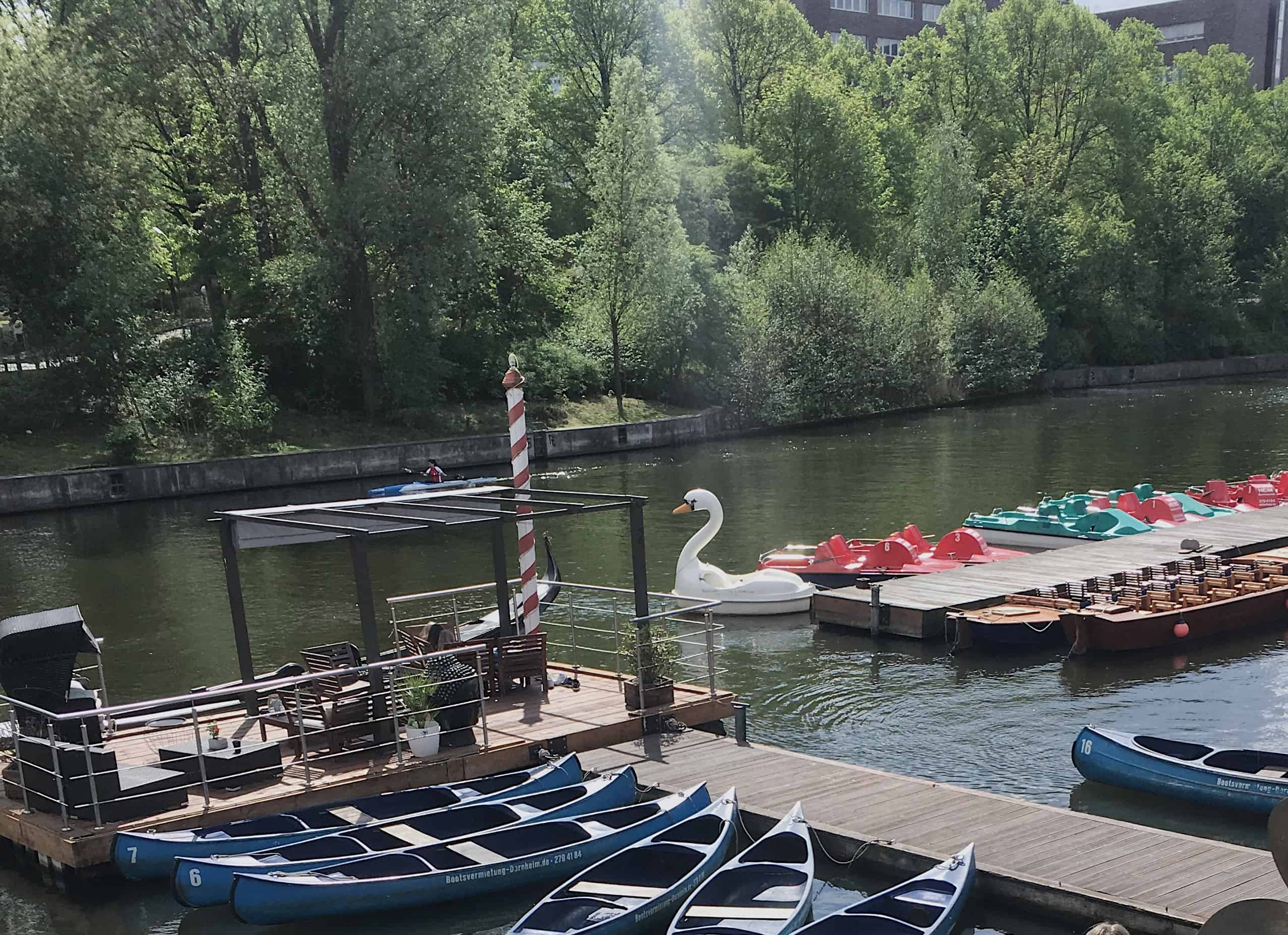 You can rent a canoe, paddleboat, or a swan boat to explore the Alster Lakes/River in Hamburg, Germany - a perfect sunny spring day activity!