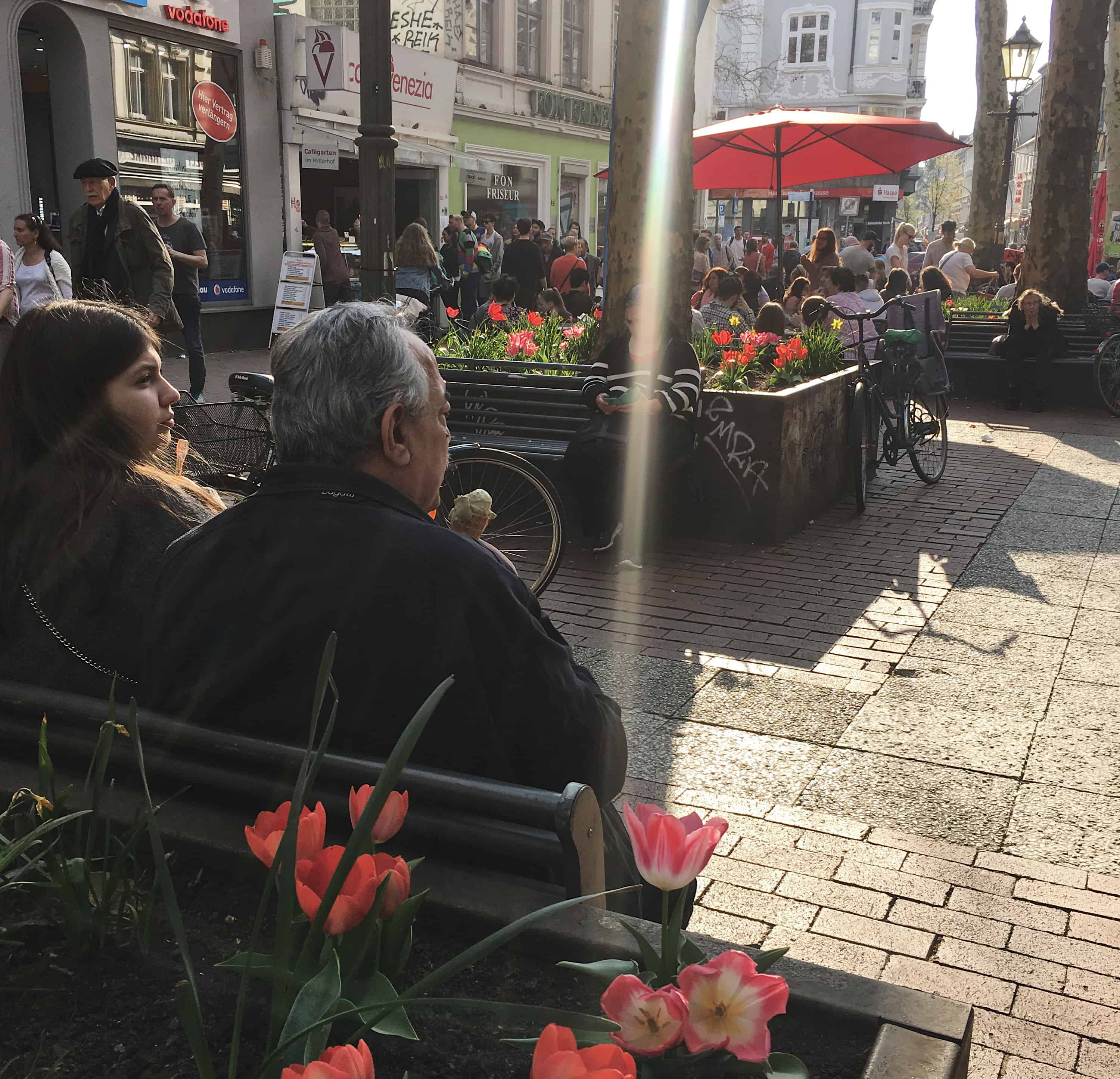 Crowds of people walking the streets in the Altona neighborhood on a sunny spring day in Hamburg, Germany