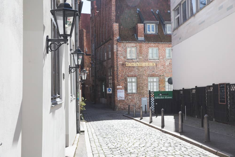 Cobblestone streets and brick buildings in Lübeck, a good day trip from Hamburg