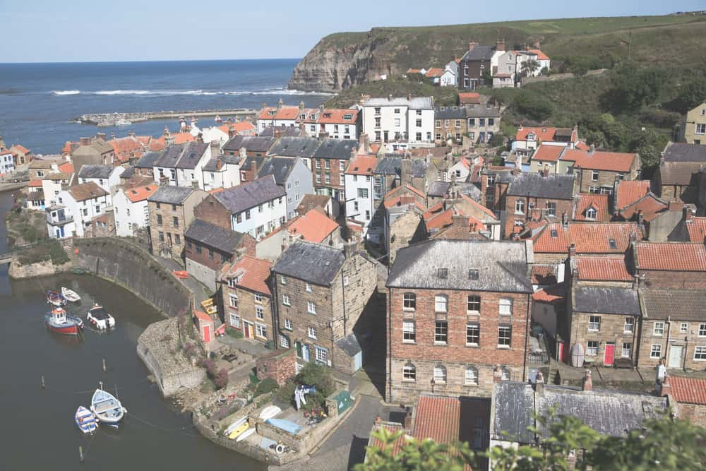 VIew of sea and houses on a sunny day in Staithes, England