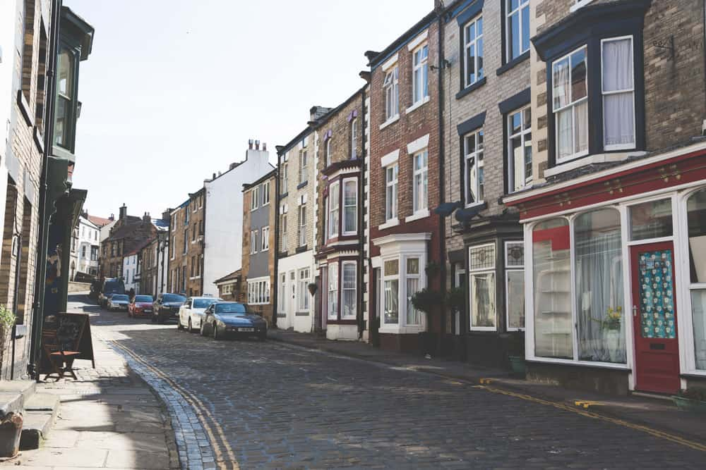 Cobblestone streets in Staithes, one of the pretty Yorkshire coastal towns to visit in England