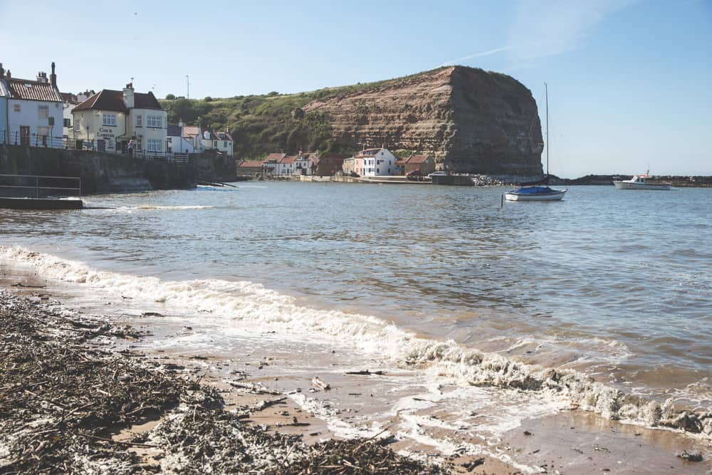 Staithes Beach in the village of Staithes, one of the pretty Yorkshire coastal towns