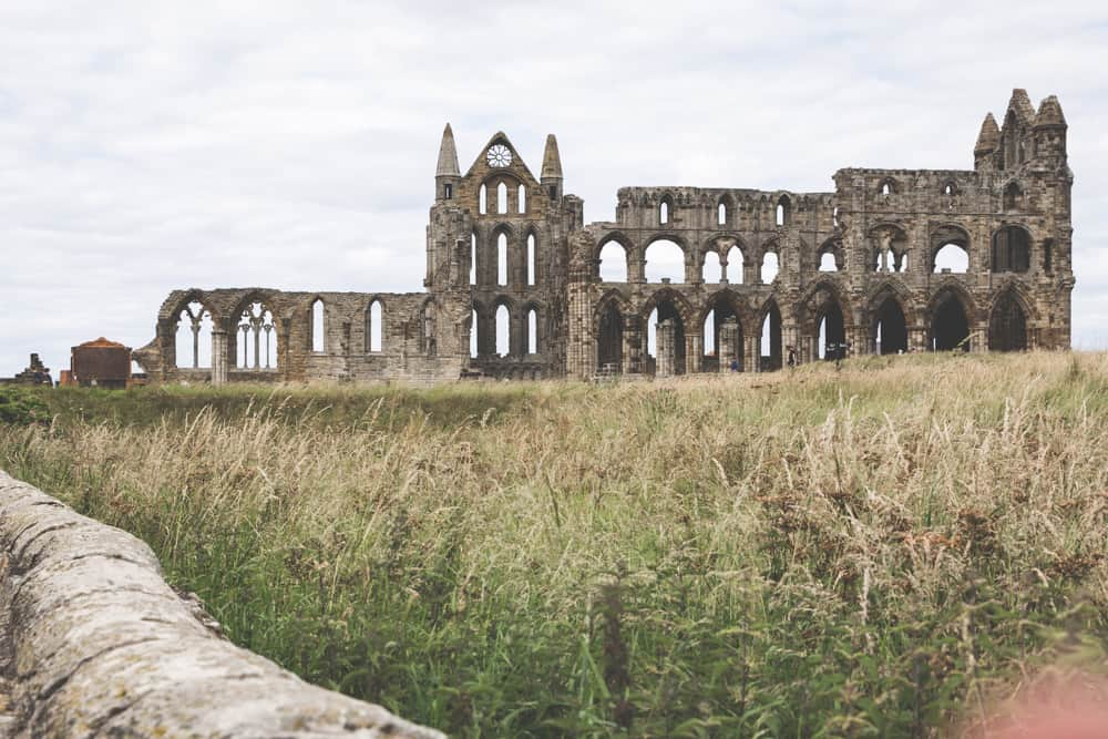 View of Whitby Abbey from the YHA Hostel gardens in Whitby, England, one of the Yorkshire coastal towns to visit
