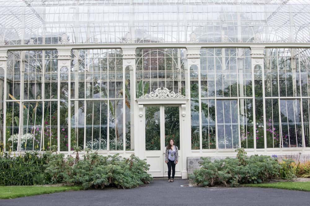 girl standing in front of national botanic gardens in dublin, ireland