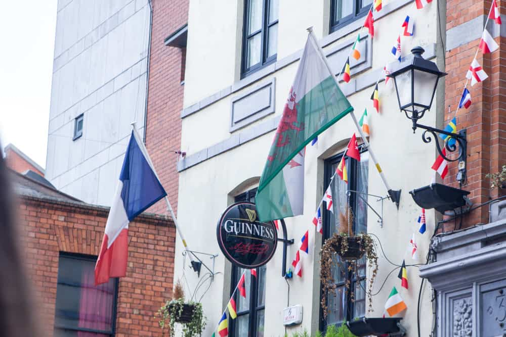 buildings with flags and guinness in dublin in ireland