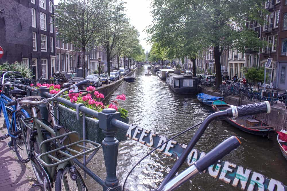 Bikes lining a canal in Amsterdam