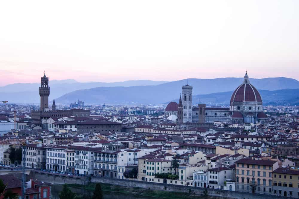view of the city of florence, italy at sunset from the piazzale michelangelo