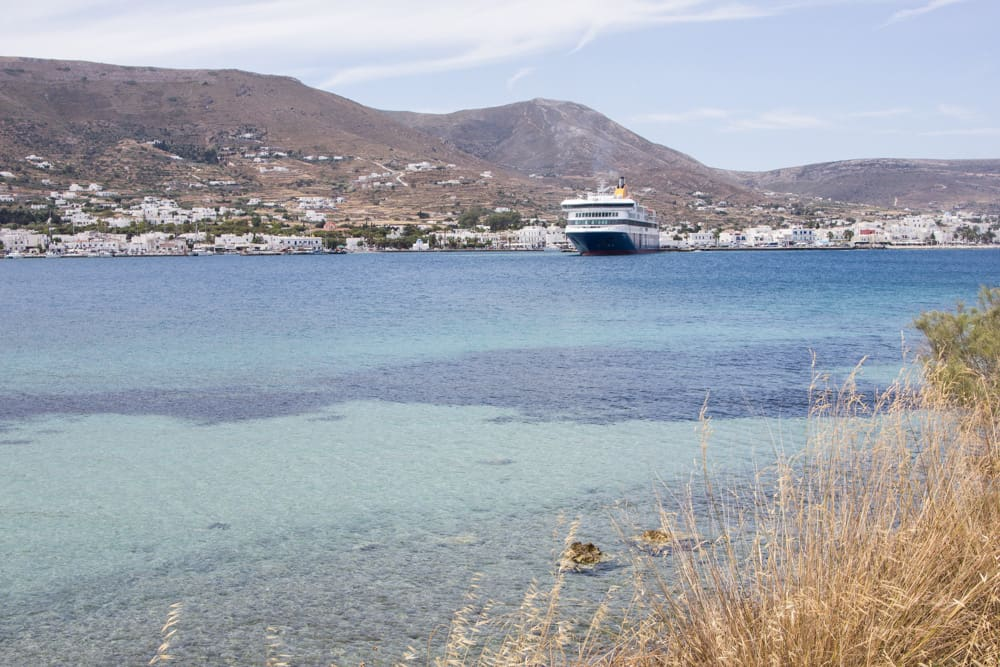 ferry on blue water in paros in greece
