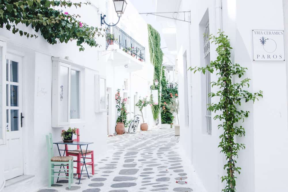 Cobblestone streets and white buildings in Paros, Greece in June