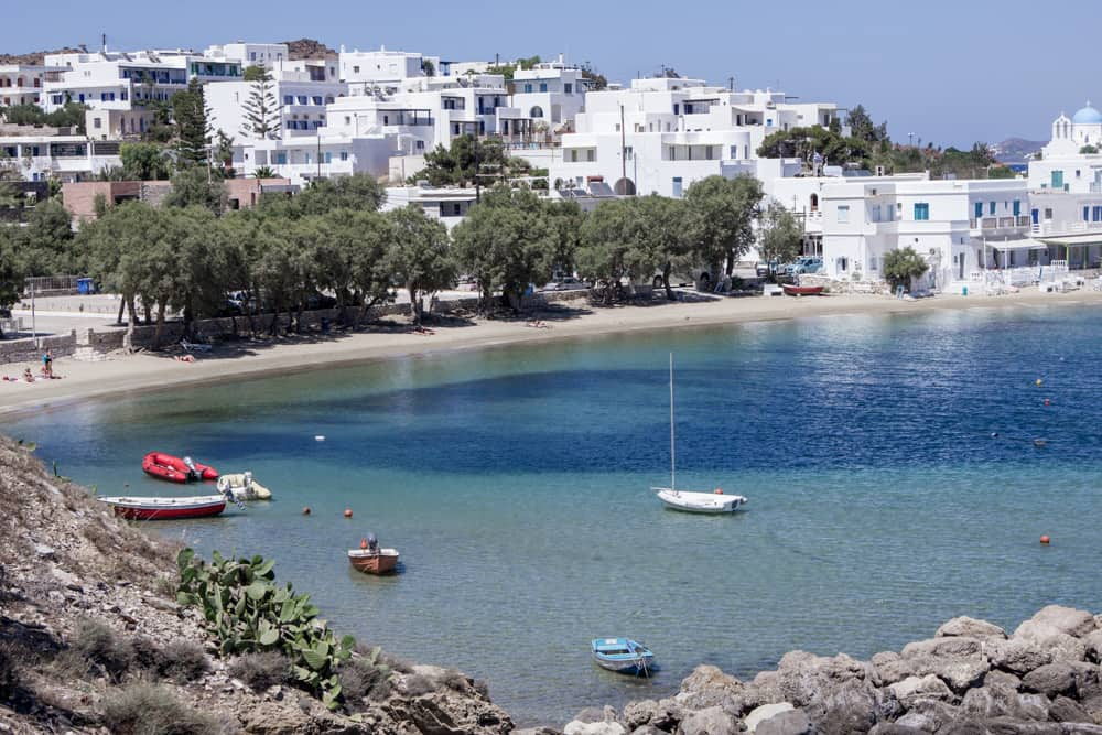 This harbor in Paros, Greece has beautiful blue water and is surrounded by white buildings!
