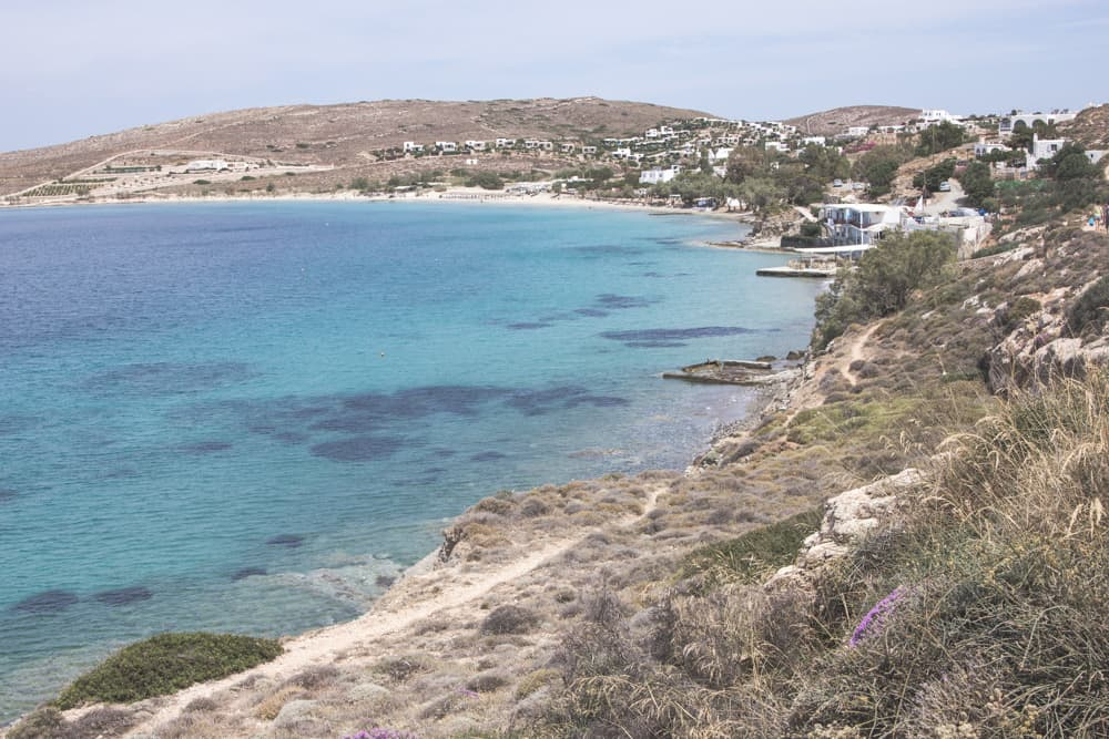 Beaches in Paros, Greece have the most beautiful blue water and are surrounded by white houses and desert plants