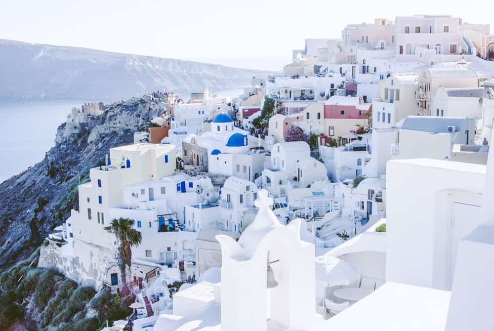 white buildings and blue domed churches on the Santorini Caldera in Greece