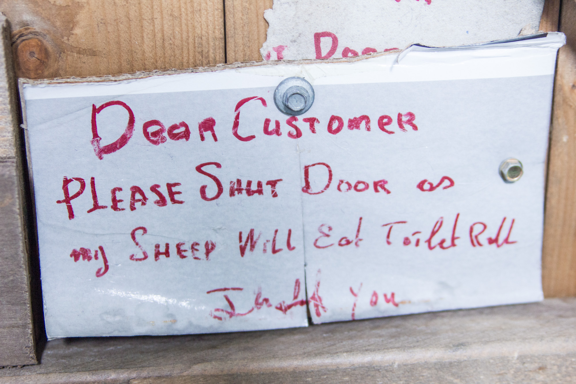 """Sign in Ireland says: """"Dear customer, please shut the door or the sheep will eat the toilet paper. Thank you."""""""