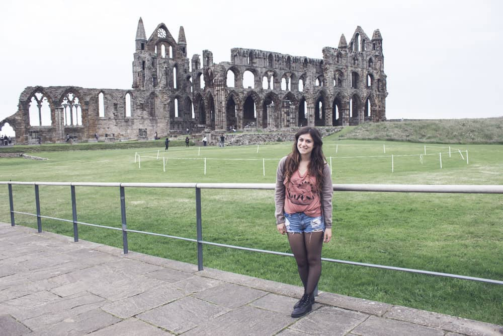 Standing in front of Whitby Abbey in England