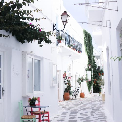 Street in Paros, Greece surrounded by white buildings