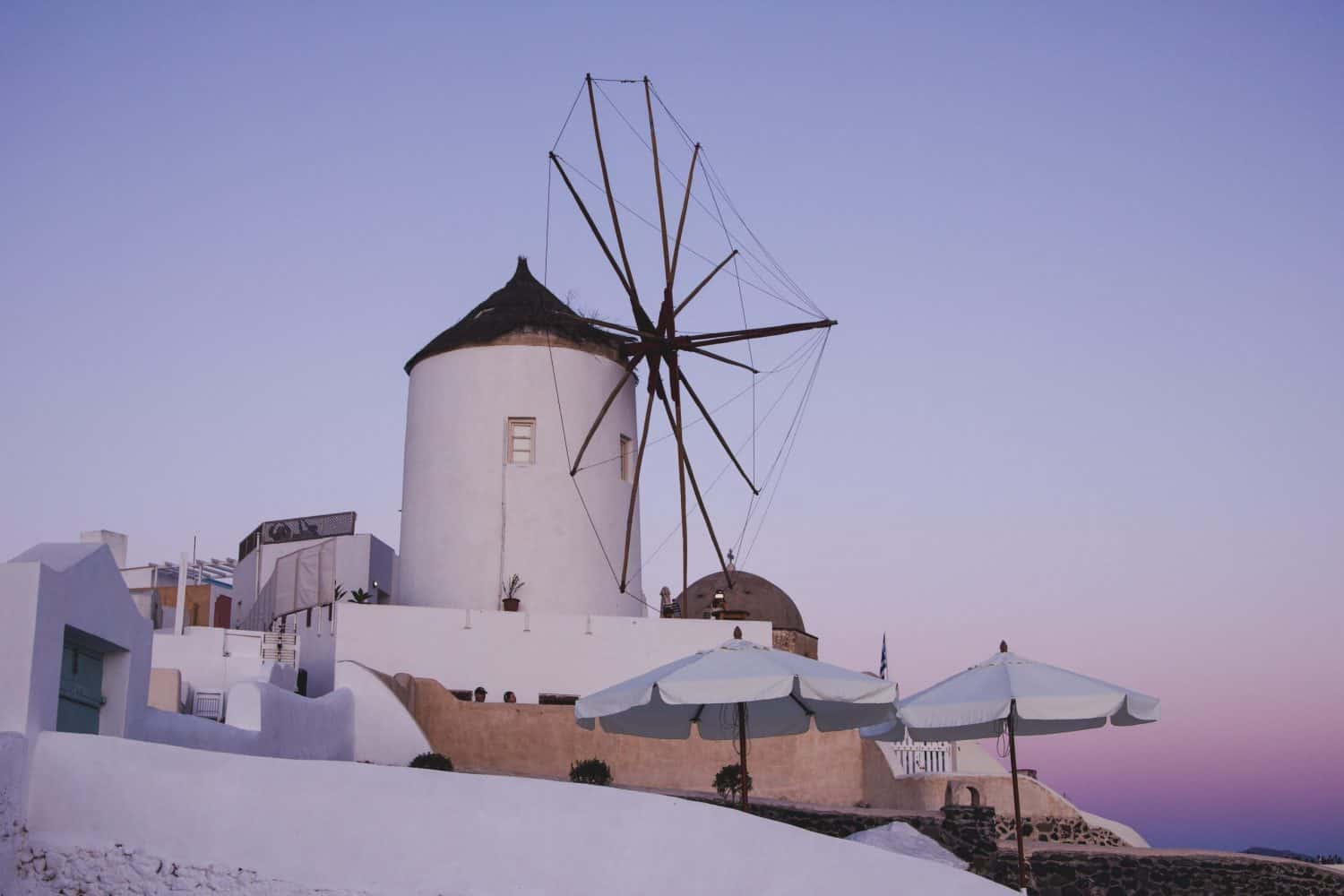Windmill in Santorini during the sunset in Oia.