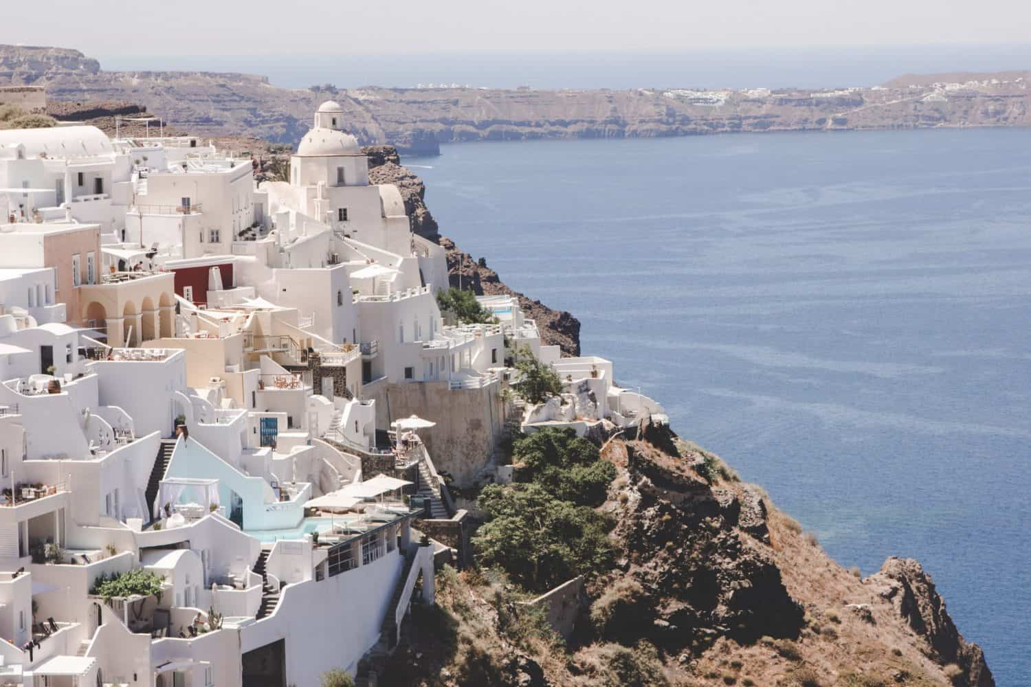 Santorini, Greece overlooking the sea. Here's what you need to know about travel to Santorini!
