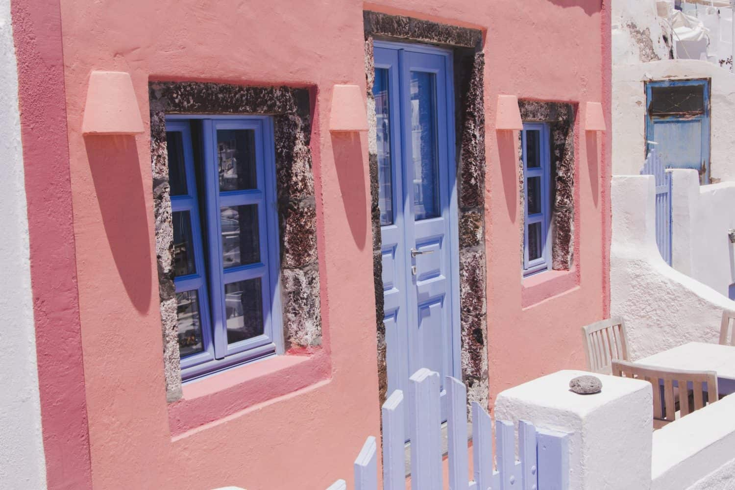 A pink and blue house in Santorini, Greece