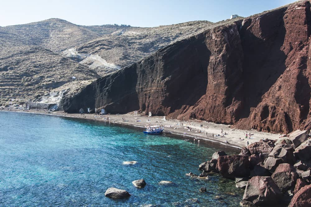 The Red Beach has the brightest blue water in Santorini, Greece - Santorini is a perfect destination for solo female travelers!