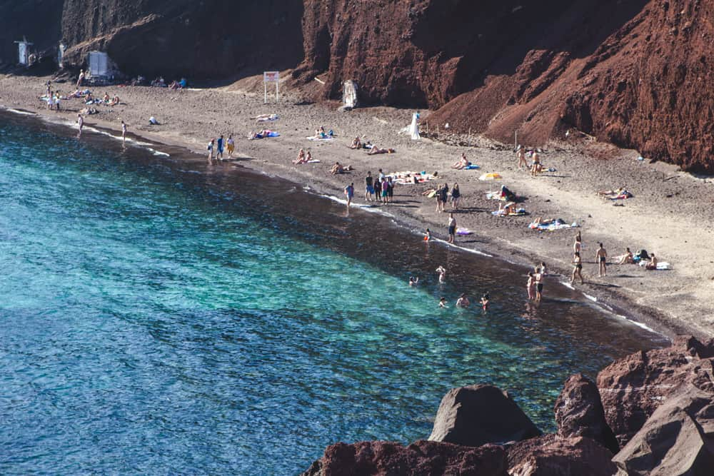 The Red Beach in Santorini, Greece and its bright blue water - Santorini is a perfect destination for solo female travelers!